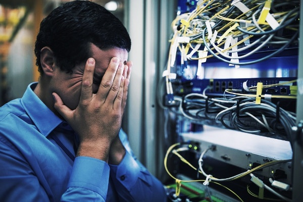 Technician getting stressed over server maintenance in server room-768496-edited.jpeg
